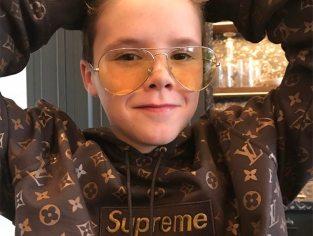 Filho de David e Victoria Beckham põe a venda moletom da Louis Vuitton & Supreme por R$ 795 mil.